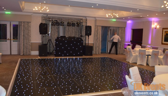 uplighters, dance floor and sparkly black LED dance floor