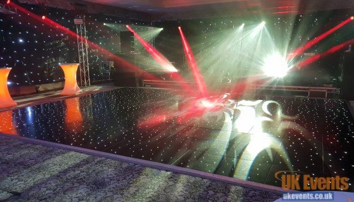 Black starlit sparkling dance floor