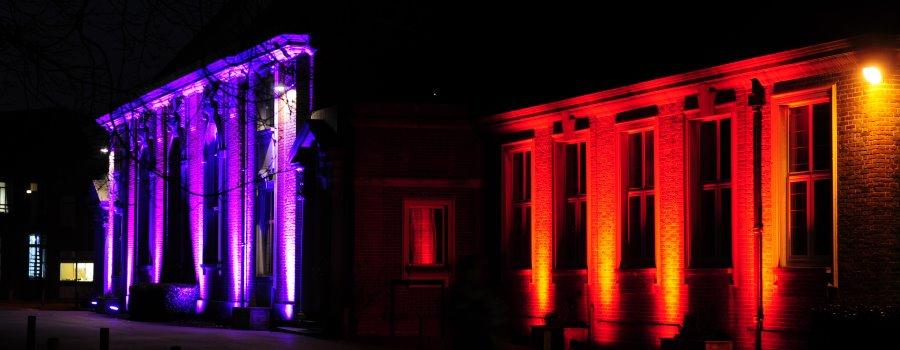 outdoor lighting up buildings with various colours