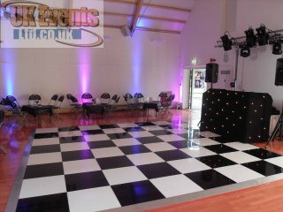 LED Coloured Uplighters and black and white dance floor