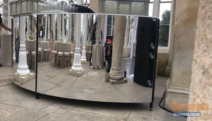 A full circular mirrored event portable bar
