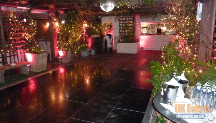 a shiny black dance floor used on a roof tarrace