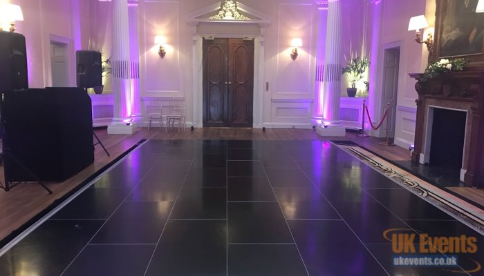 a lovely black floor used in a hotel room for a private function