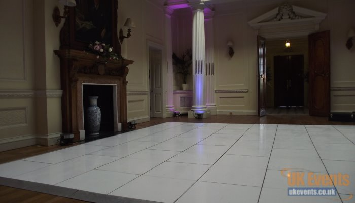 A stunning white wedding dance floor hired