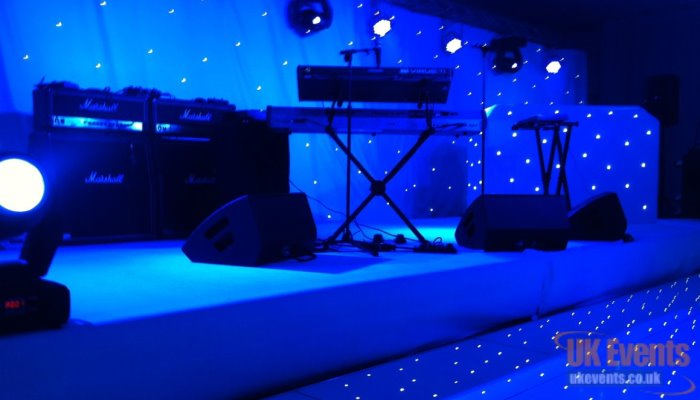 a band stage dressed in black carpet at 30cm high