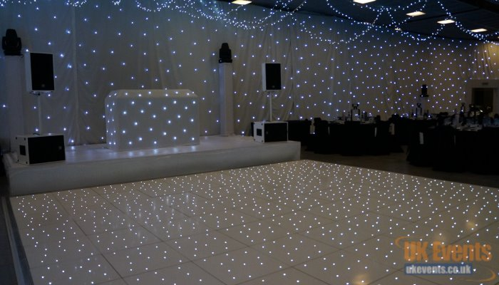 transforming a function room with a white starcloth backdrop in Cambridgeshire