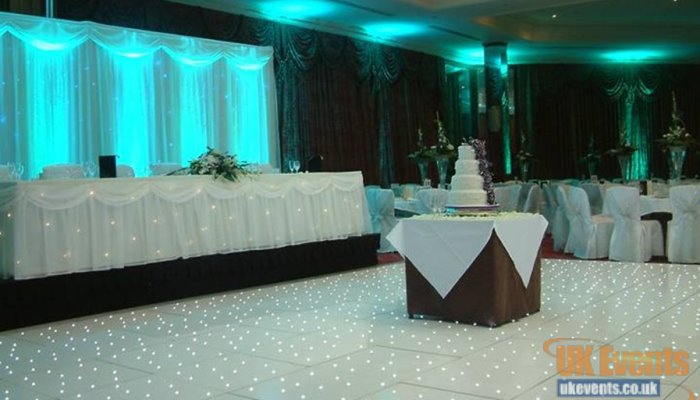 A white starlit dance floor for a wedding reception