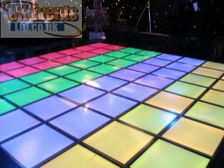 a multi colour light up dance floor which is raised