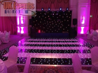 pink and black striped dance floor