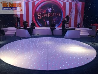 corporate function with a white rgb circular dance floor