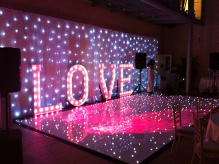 Love letters, starcloth backdrop and sparkly dance floor Bedfordshire