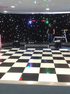 Black star cloth with chequered dance floor